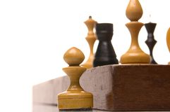 Chessmen on a chessboard Stock Images