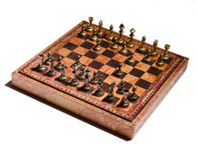 Chessmen on a chessboard Stock Image