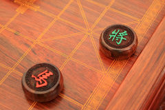 Chessmen of chinese chess china. In woodiness board stock image