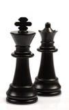 Chessmen noirs sur un échiquier Images libres de droits