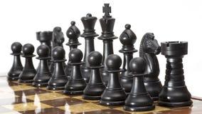 Chessmen på hans stiger ombord. Arkivfoto