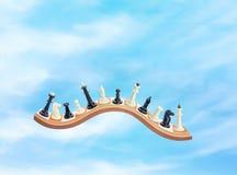 Chessmen in the sky. Chessmen on the waved board in the sky Stock Photo