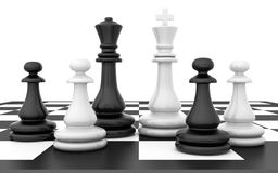 Chessmen stand on chessboard Royalty Free Stock Images