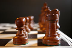 Chesspieces on board. Chess pieces on board at start of the game Royalty Free Stock Photo