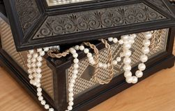 Chest. Old chest with pearl necklace stock photo
