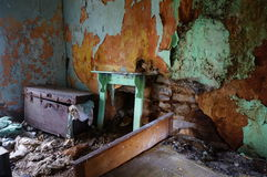 Chest in abandoned old house. Chest and peeling wall in abandoned old house in ireland Stock Photography