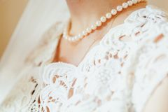 Chest of beautiful bride wearing pearl Necklace. Close up shot royalty free stock photos