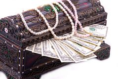 Chest box filled with money and jewellery Stock Photo