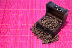 Chest with coffee beans Royalty Free Stock Images