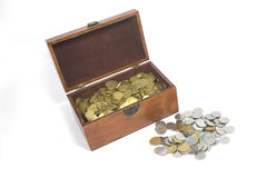 Chest with coins. Coins lie in a small wooden chest Stock Photography