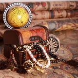 Chest, compass, globe on antique map. Antique chest with jewelry, compass, globe on vintage map Stock Images