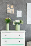 Chest of drawers against grey wall Stock Images