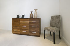 Chest of drawers and a chair royalty free stock photos