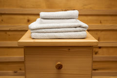 Chest of drawers with a clean towel Royalty Free Stock Photography