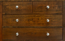 Chest of drawers closeup. Contemporary wood chest of drawers closeup Stock Images