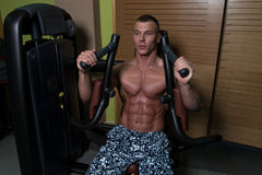 Chest Exercise On Machine In Gym Royalty Free Stock Image