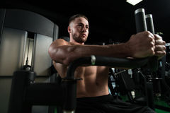 Chest Exercise On Machine In Gym Royalty Free Stock Images