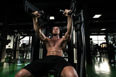 Chest Exercise On Machine In Gym Stock Photos