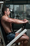 Chest Exercises On A Machine Royalty Free Stock Image
