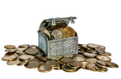 Chest full of coins on on a pile of coins Stock Photos