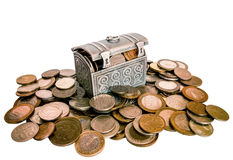 Chest full of coins on on a pile of coins Royalty Free Stock Image