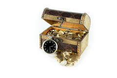 Chest full of gold coins of the old clock Royalty Free Stock Photography