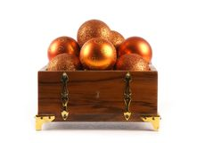 A chest full of golden Christmals balls Stock Image