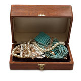 Chest full of jewelry treasures. Isolate on white Stock Photo