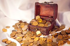 The chest of gold. Wooden retro treasure chest full of gold coins royalty free stock photos
