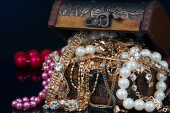 Chest with jewels on dark background Stock Photo