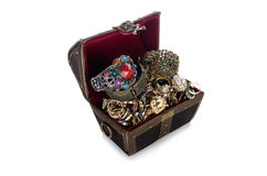 The chest with lots of jewellery isolated on white Stock Images