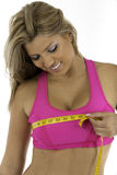 Chest Measurement. Pretty woman happy with her bust or chest measurement Royalty Free Stock Image