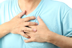 Chest pain. Asian man with chest pain, isolated on white Stock Image