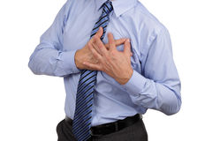 Chest pain. Businessman with chest pain clutching his chest concept for heart attack, stoke or asthmatic royalty free stock photo