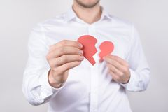 Chest pain ache attack heartache health unhealthy care healthcare problem concept. Cropped close up photo of small heart in hands. Isolate grey background royalty free stock image