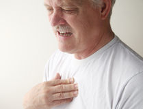 Chest pain in older man Stock Photos