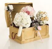 Chest and silk flowers. An image of silk wedding flowers in a treasure chest royalty free stock photos