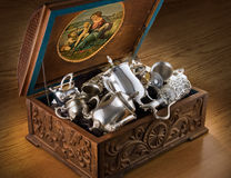 Chest with silver tableware. Carved chest with silver tableware Stock Photos