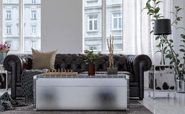 Chest style coffee table in front of Chesterfield Stock Images