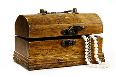 Chest with treasures on white Royalty Free Stock Images