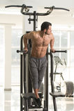 Chest And Triceps Exercise on Parallel Bars Royalty Free Stock Photos
