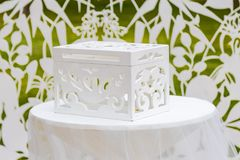 Chest for wedding gifts. Wedding dresses in white colors.  Royalty Free Stock Images