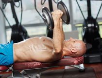 Chest workout at bench press Stock Images
