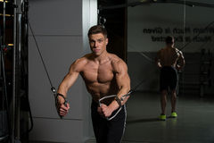 Chest Workout Cable Crossover. Young Bodybuilder Is Working On His Chest With Cable Crossover In A Dark Gym stock photos