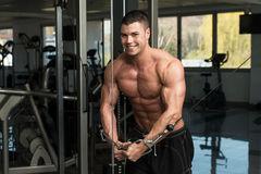 Chest Workout Cable Crossover. Young Bodybuilder Is Working On His Chest With Cable Crossover In A Dark Gym stock image