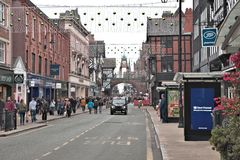 Chester Foregate street before Christmas 2016. Chester, Cheshire, UK - October 30, 2016: Foregate street with traditional black english taxi cab. Chester Royalty Free Stock Photo