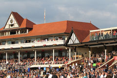 Chester races. A crowd of punters in thew stand at the Chester race course in Cheshire England stock images