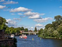 Chester River Dee UK. Panorama of River and Roman Walls in Chester UK showing the river,the roman city walls and part of the Old Bridge with a church in the royalty free stock photo