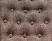 Chesterfield styled furniture with buttons closeup. Chesterfield styled furniture with buttons close up. Decorated sofa back background Royalty Free Stock Photos