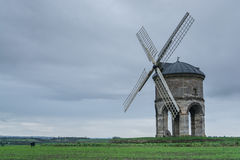Chesterton Windmill. Is a 17th-century cylindric stone tower windmill with an arched base, located outside the village of Chesterton, Warwickshire, England Royalty Free Stock Images